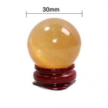 Натуральный шар  из желтого кристала на подставке,диаметр 30 мм